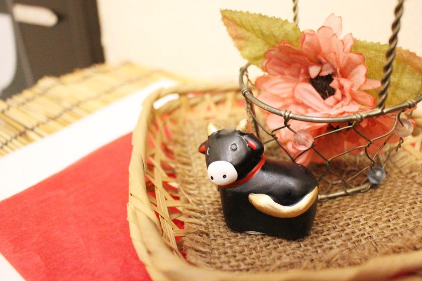 西公園商工連盟の「福岡のお粥カフェ Teddy & Daddy テディ&ダディ」の店内に置かれている牛の置物です。